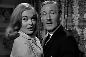 A Weekend With Lulu. Image shows from L to R: Deirdre Bell (Shirley Eaton), Timothy Grey (Leslie Phillips).