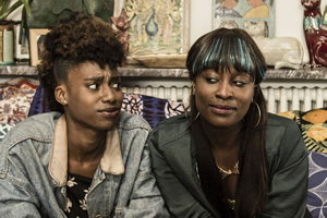 Ackee & Saltfish. Image shows from L to R: Olivia (Michelle O Tiwo), Rachel (Vanessa Babirye). Copyright: BBC.