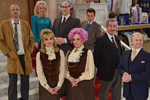 Are You Being Served?. Image shows from L to R: Mr Harman (Arthur Smith), Miss Croft (Jorgie Porter), Miss Brahms (Niky Wardley), Mr Rumbold (Justin Edwards), Mrs Slocombe (Sherrie Hewson), Young Mr Grace (Mathew Horne), Captain Peacock (John Challis), Mr Humphries (Jason Watkins). Copyright: BBC.