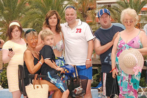 Benidorm. Image shows from L to R: Chantelle Garvey (Hannah Hobley), Madge (Sheila Reid), Michael Garvey (Oliver Stokes), Janice Garvey (Siobhan Finneran), Mick Garvey (Steve Pemberton), The Oracle (Johnny Vegas), Noreen Maltby (Elsie Kelly). Image credit: Tiger Aspect Productions.