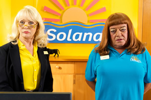 Benidorm. Image shows from L to R: Joyce Temple Savage (Sherrie Hewson), Les / Lesley (Tim Healy). Copyright: Tiger Aspect Productions.