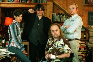 Black Books. Image shows from L to R: Fran Katzenjammer (Tamsin Greig), Bernard Black (Dylan Moran), Manny Bianco (Bill Bailey), Evan (Simon Pegg). Copyright: Assembly Film And Television.