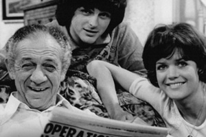 Bless This House. Image shows from L to R: Sid Abbott (Sid James), Mike Abbott (Robin Stewart), Sally Abbott (Sally Geeson).