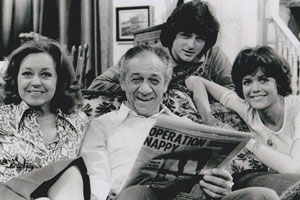 Bless This House. Image shows from L to R: Jean Abbott (Diana Coupland), Sid Abbott (Sid James), Mike Abbott (Robin Stewart), Sally Abbott (Sally Geeson). Copyright: Thames Television.