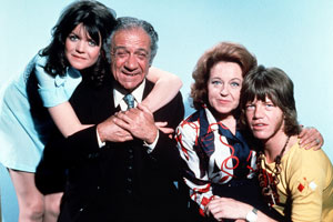 Bless This House. Image shows from L to R: Sally Abbot (Sally Geeson), Sid Abbot (Sid James), Jean Abbot (Diana Coupland), Mike Abbot (Robin Askwith).