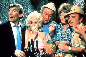 Carry On Abroad. Image shows from L to R: Stuart Farquhar (Kenneth Williams), Sadie Tomkins (Barbara Windsor), Vic Flange (Sidney James), Cora Flange (Joan Sims), Stanley Blunt (Kenneth Connor). Copyright: Peter Rogers Productions.