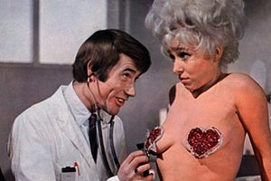 Carry On Again Doctor. Image shows from L to R: Maud 'Goldie Locks' Boggins (Barbara Windsor), Dr James Nookey (Jim Dale).