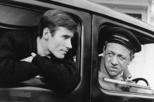 Carry On Cabby. Image shows from L to R: Jeremy (Jim Dale), Charlie Hawkins (Sid James). Copyright: Peter Rogers Productions / Studio Canal.