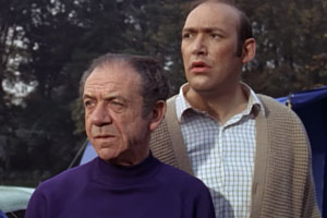 Carry On Camping. Image shows from L to R: Sid Boggle (Sid James), Bernie Lugg (Bernard Bresslaw). Copyright: ITV Studios.