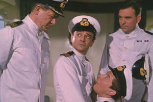 Carry On Cruising. Image shows from L to R: Captain Wellington Crowther (Sid James), Dr Arthur Binn (Kenneth Connor), First Officer Leonard Marjoribanks (Kenneth Williams), Unknown.