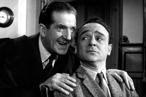 Carry On Teacher. Image shows from L to R: Mr. William Wakefield (Ted Ray), Mr. Gregory Adams (Kenneth Connor). Copyright: Peter Rogers Productions.