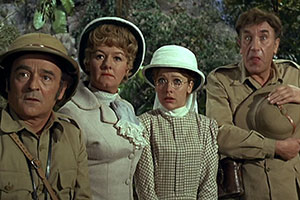 Carry On Up The Jungle. Image shows from L to R: Claude Chumley (Kenneth Connor), Lady Evelyn Bagley (Joan Sims), June (Jacki Piper), Prof. Inigo Tinkle (Frankie Howerd). Copyright: Peter Rogers Productions / Rank Organisation.