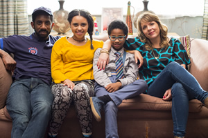 Carters Get Rich. Image shows from L to R: Tony Carter (Rhashan Stone), Ellie Carter (Rhianna Merralls), Harry Carter (Rio Chambers), Liz Carter (Kerry Godliman). Copyright: Roughcut Television.