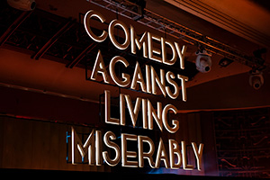 Comedy Against Living Miserably.