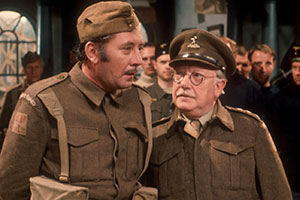 Dad's Army. Image shows from L to R: Private Walker (James Beck), Captain Mainwaring (Arthur Lowe). Copyright: BBC.