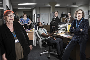 Damned. Image shows from L to R: Rose Denby (Jo Brand), Natalie Moore (Isy Suttie), Nitin (Himesh Patel), Martin Bickerstaff (Kevin Eldon), Denise Donnelly (Georgie Glen), Al Kavanagh (Alan Davies). Copyright: What Larks Productions.