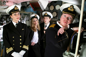 Deep Trouble. Image shows from L to R: Commander Alison Fairbanks (Katherine Jakeways), Petty Officer Lucy Radcliffe (Miranda Raison), Lieutenant Jack Trainor (Ben Willbond), Captain Paul Wade (Jim Field Smith). Copyright: Pozzitive Productions.