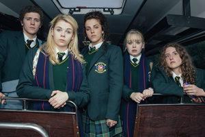 Derry Girls. Image shows from L to R: James Maguire (Dylan Llewelyn), Erin Quinn (Saoirse Jackson), Michelle Mallon (Jamie-Lee O'Donnell), Clare Devlin (Nicola Coughlan), Orla McCool (Louisa Harland). Copyright: Hat Trick Productions.