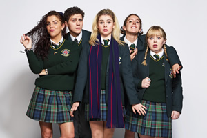 Derry Girls. Image shows from L to R: Michelle Mallon (Jamie-Lee O'Donnell), James Maguire (Dylan Llewellyn), Erin Quinn (Saoirse-Monica Jackson), Orla McCool (Louisa Harland), Clare Devlin (Nicola Coughlan). Copyright: Hat Trick Productions.