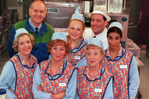 dinnerladies. Image shows from L to R: Jean (Anne Reid), Stan (Duncan Preston), Brenda (Victoria Wood), Twinkle (Maxine Peake), Dolly (Thelma Barlow), Tony (Andrew Dunn), Anita (Shobna Gulati). Copyright: Good Fun / Pozzitive Productions.