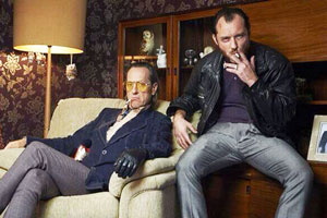 Dom Hemingway. Image shows from L to R: Dickie (Richard E. Grant), Dom Hemingway (Jude Law).