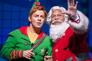 Elf: The Musical. Image shows from L to R: Buddy (Ben Forster), Santa Claus (Louis Emerick).