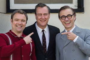 Eric, Ernie And Me. Image shows from L to R: Ernie Wise (Neil Maskell), Eddie Braben (Stephen Tompkinson), Eric Morecambe (Mark Bonnar). Copyright: Objective Productions.