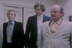 Eskimo Nell. Image shows from L to R: Harris Tweedle (Christopher Timothy), Denis Morrison (Michael Armstrong), Benny U. Murdoch (Roy Kinnear). Copyright: Salon Productions.