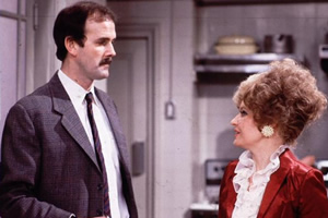 Fawlty Towers. Image shows from L to R: Basil Fawlty (John Cleese), Sybil Fawlty (Prunella Scales). Copyright: BBC.