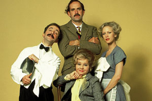 Fawlty Towers. Image shows from L to R: Manuel (Andrew Sachs), Basil Fawlty (John Cleese), Sybil Fawlty (Prunella Scales), Polly (Connie Booth). Copyright: BBC.