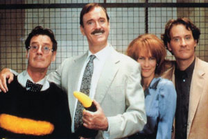 Fierce Creatures. Image shows from L to R: Adrian (Michael Palin), Rollo Lee (John Cleese), Willa Weston (Jamie Lee Curtis), Vince McCain (Kevin Kline).