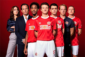 The First Team. Image shows from L to R: Olivia Talbot (Tamla Kari), Mark Crane (Will Arnett), Benji Achebe (Shaquille Ali-Yebuah), Mattie Sullivan (Jake Short), Jack Turner (Jack McMullen), Chris Booth (Chris Geere), Petey Brooks (Theo Barklem-Biggs).