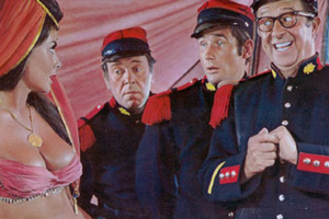 Follow That Camel. Image shows from L to R: Corktip (Anita Harris), Simpson (Peter Butterworth), Bertram 'Bo' Oliphant West (Jim Dale), Sergeant Ernie Nocker (Phil Silvers). Copyright: Peter Rogers Productions.