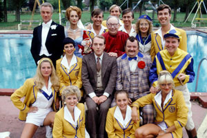 Hi-De-Hi!. Image shows from L to R: Mary (Penny Irving), Barry Stuart-Hargreaves (Barry Howard), Gladys Pugh (Ruth Madoc), Unknown, Yvonne Stuart-Hargreaves (Diane Holland), Stanley Matthews (David Webb), Jeffrey Fairbrother (Simon Cadell), Mr Partridge (Leslie Dwyer), Gary Bolton (Chris Andrews), Unknown, Bruce Matthews (Tony Webb), Ted Bovis (Paul Shane), Peggy Ollerenshaw (Su Pollard), Spike Dixon (Jeffrey Holland), Betty Whistler (Rikki Howard), Fred Quilly (Felix Bowness). Copyright: BBC.