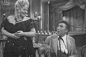 Howerd's Hour. Image shows from L to R: Hot Seat Kate (Hattie Jacques), Frankie Howerd. Copyright: ABC Television.