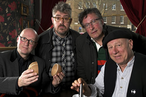 In Transit. Image shows from L to R: Ade (Adrian Edmondson), Phill (Phill Jupitus), Rowland (Rowland Rivron), Neil (Neil Innes). Copyright: Giddy Goat Productions.