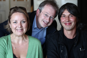 The Infinite Monkey Cage. Image shows from L to R: Alexandra Feachem, Robin Ince, Brian Cox.