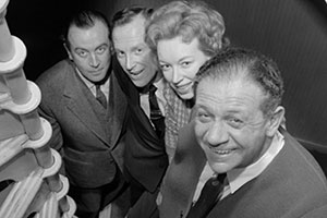 It's A Deal. Image shows from L to R: Dennis (Dennis Price), Wallas Eaton, Mollie (June Whitfield), Sid (Sid James). Copyright: BBC.