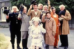 Photograph courtesy of Revelation Films. Image shows from L to R: Policeman (Jimmy Edwards), Chauffeur (Brian Murphy), Big Removal Man (Tommy Cooper), Grand Lady (Irene Handl), Bearded Removal Man (Noel Murphy), Head Removal Man (Eric Sykes), Little Removal Man (Johnny Vyvyan), Road-sweeper (Andrew Sachs), Old Removal Man (Bob Todd). Copyright: Thames Television.