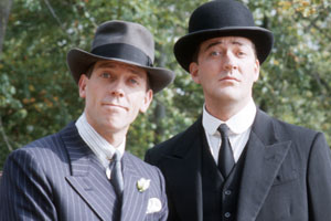Jeeves And Wooster. Image shows from L to R: Bertie Wooster (Hugh Laurie), Jeeves (Stephen Fry). Copyright: Picture Partnership Productions.