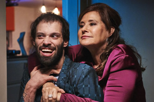 Jerk. Image shows from L to R: Tim (Tim Renkow), Tim's Mom (Lorraine Bracco).