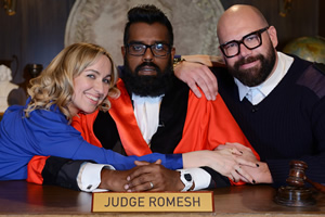 Judge Romesh. Image shows from L to R: Court Clerk (Kerry Howard), Romesh Ranganathan, Court Bailiff (Tom Davis). Copyright: Hungry Bear Media.