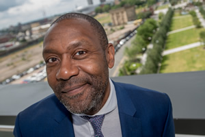 Birmingham City University Chancellor, Sir Lenny Henry, poses in front of the institution's City Centre Campus, from the balcony of the University's new £63 million Curzon Building. Lenny Henry. Copyright: Birmingham City University.