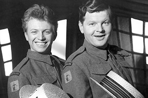 Light Up The Sky!. Image shows from L to R: Gunner Eric McCaffey (Tommy Steele), Gunner Syd McCaffey (Benny Hill).