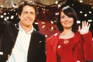 Love Actually. Image shows from L to R: David, The Prime Minister (Hugh Grant), Natalie (Martine McCutcheon). Copyright: Working Title Films.