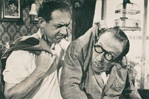Make Mine A Million. Image shows from L to R: Sid Gibson (Sid James), Arthur Ashton (Arthur Askey).