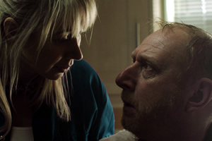 Making A Killing. Image shows from L to R: The Handyperson (Tiffany Stevenson), Mr Loveless (Adrian Scarborough).