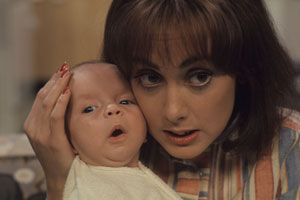 Miss Jones And Son. Image shows from L to R: Baby Roland (Luke Steensil), Elizabeth Jones (Paula Wilcox). Copyright: Thames Television.