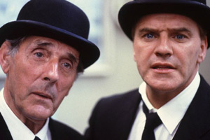 Photograph courtesy of Revelation Films. Image shows from L to R: Senior Undertaker (Eric Sykes), Short Undertaker (Freddie Starr). Copyright: Thames Television.