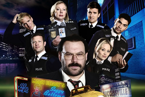 Murder In Successville. Image shows from L to R: Jamie Laing, Dermot O'Leary, Deborah Meaden, DI Sleet (Tom Davis), Greg James, Kimberly Wyatt, Louis Smith. Copyright: Tiger Aspect Productions.